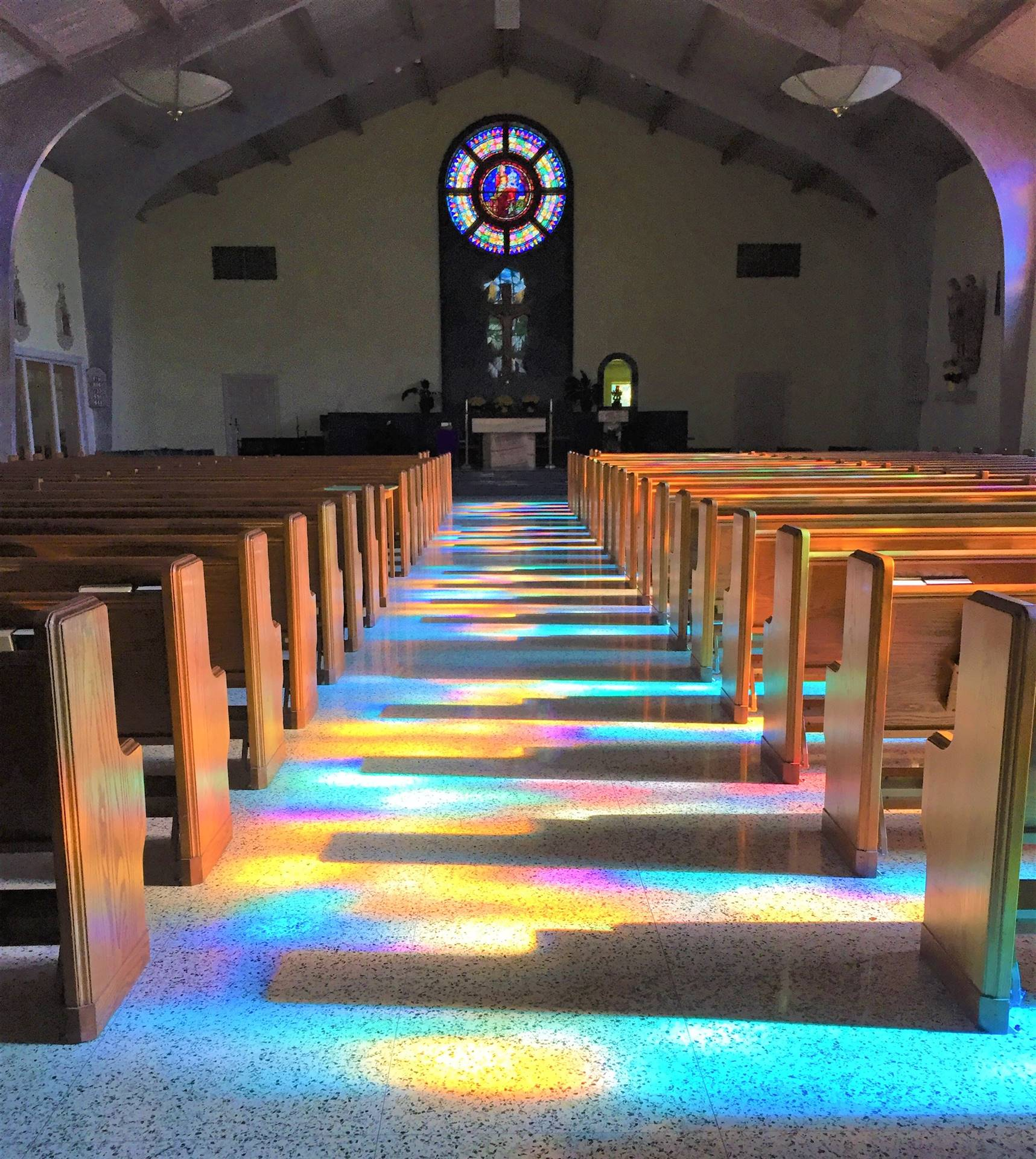 Stained Glass Windows Shining Into the Church